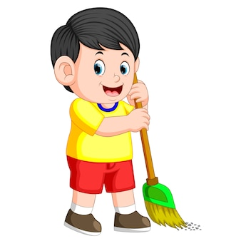 Boy with the black hair is sweeping the trash with the green broom