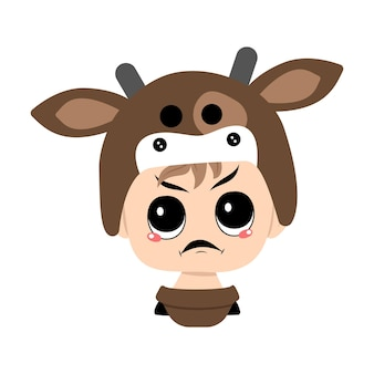 Boy with blonde hair and angry emotions grumpy face furious eyes in cow hat head of cute child with ...