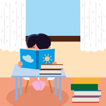 Мальчик с книгами за столом учится дома