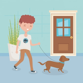 Boy with dog walking in the room pet care