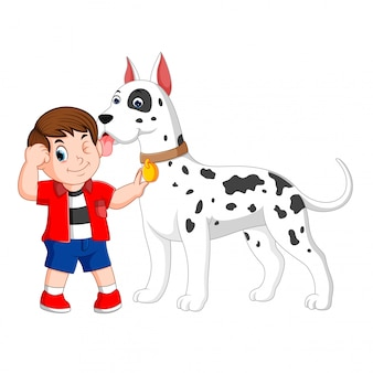 A boy with the red shirt is holding his big white dalmatian dog