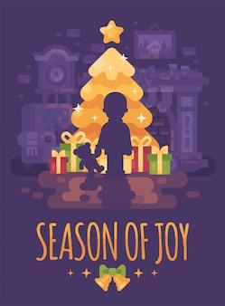 A boy with teddy bear near christmas tree with presents