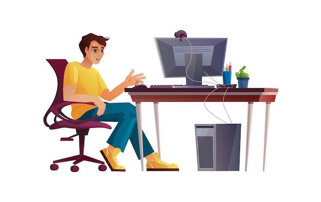 Мальчик работает из домашнего офиса, студент или фрилансер за компьютерным столом.