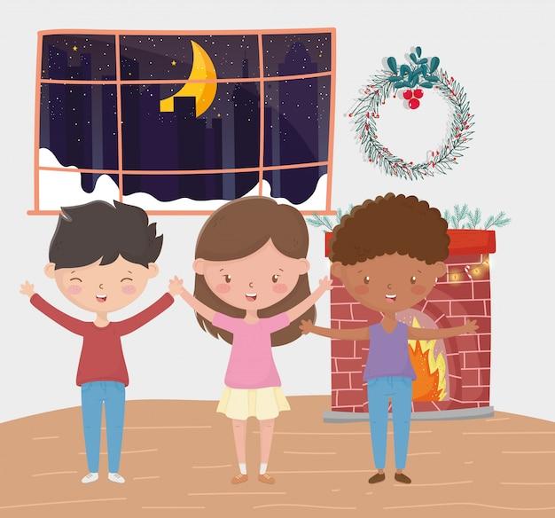 男の子と女の子の煙突の花輪部屋夜メリークリスマス