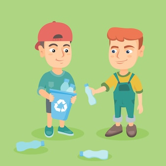 Boys collecting plastic bottles for recycling.