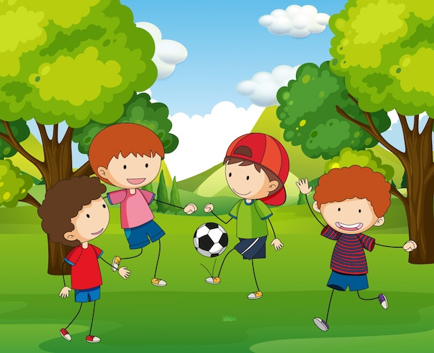 Boys playing football in the park