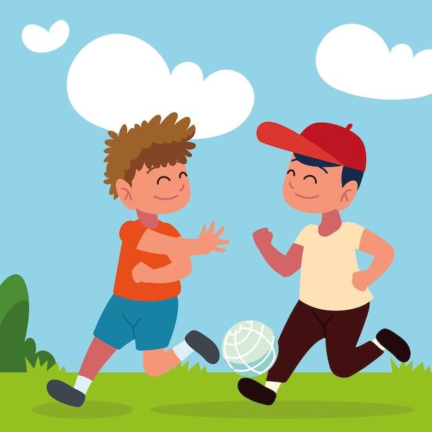 Мальчики играют с мячом на открытом воздухе