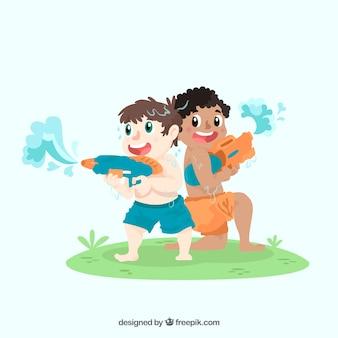 水銃で遊んでいる男の子