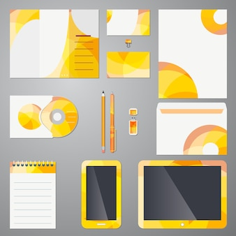 Brand identity template on stationery  mobile devices and office supplies wit a colorful yellow and orange modern circular pattern