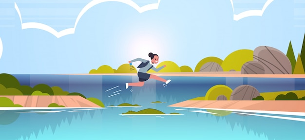 Brave businesswoman jumping over river with crocodiles risk and danger optimism determination concept business woman running to goal landscape background full length flat horizontal