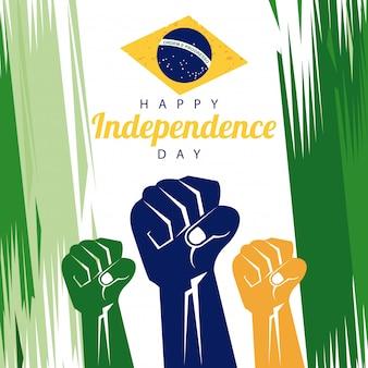 Празднование дня независимости бразилии с флагом и раскрашенными руками в кулаки