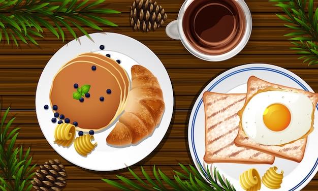 Завтрак крупным планом на фоне стола с некоторыми опорами листьев