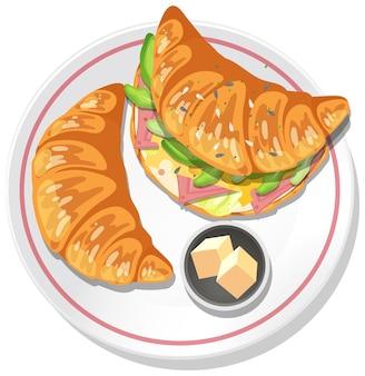 分離されたプレート上のバターと朝食クロワッサンサンドイッチ