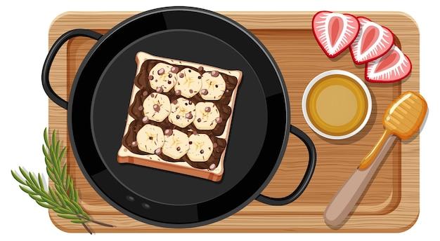 도마와 함께 냄비에 아침 식사 세트