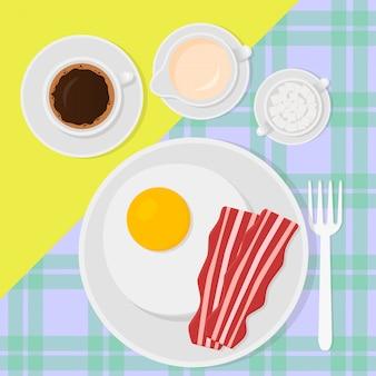 スクランブルエッグ、ベーコン、コーヒー、牛乳のあるフラットスタイルの朝食上面図。