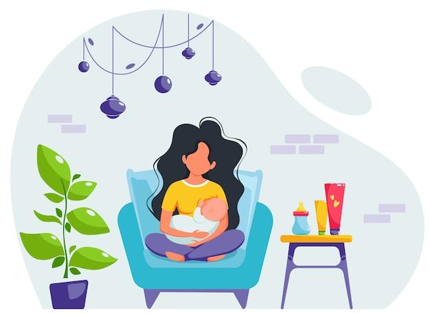 母乳育児のコンセプトです。肘掛け椅子に座って女性の胸に授乳。