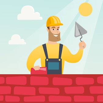 Bricklayer working with spatula and brick.
