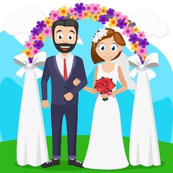 アーチ近くの式典で新郎新婦。結婚式