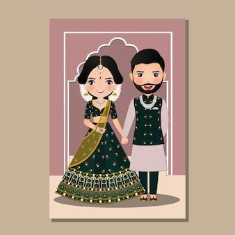 伝統的なインドのドレス漫画で新郎新婦のかわいいカップル。
