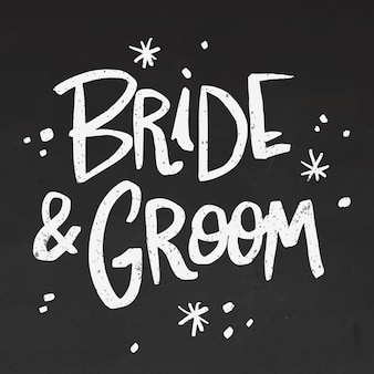 Bride and groom lettering on blackboard