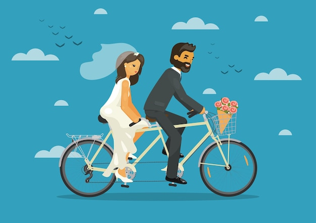 Bride and groom together riding tandem bike with heart balloons in the sky wedding concept