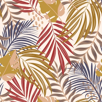 Bright abstract seamless pattern with colorful tropical leaves and flowers on delicate background