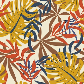 Bright abstract seamless pattern with colorful tropical leaves and plants on beige