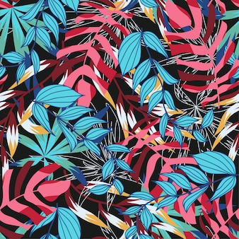 Bright abstract seamless pattern with colorful tropical leaves and plants on dark