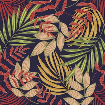 Bright abstract seamless pattern with colorful tropical leaves and plants on purple background