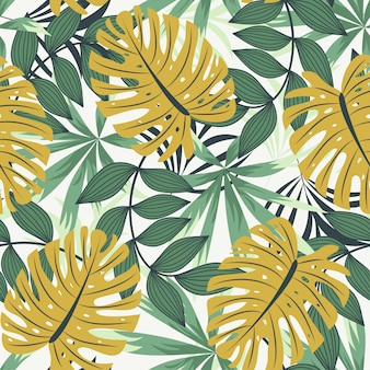 Bright abstract seamless pattern with colorful tropical leaves and plants on white