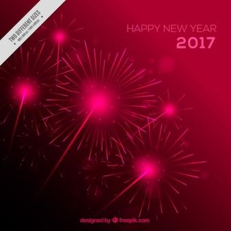 Sfondo luminoso con fuochi d'artificio per capodanno s 'anno