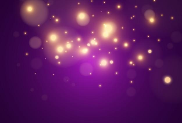 透明な背景に明るく美しい黄金の火花。