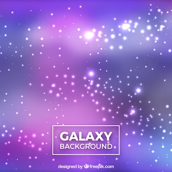 Bright blurred background of galaxies
