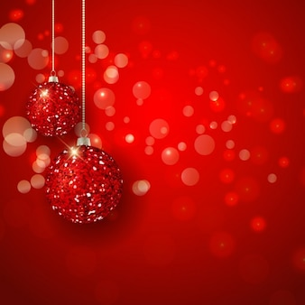 Bright christmas balls on a red bokeh background