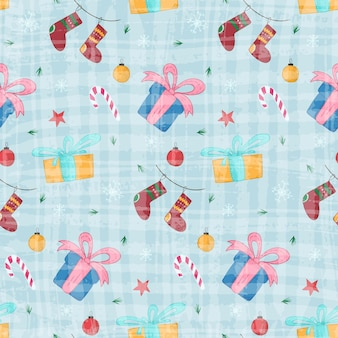Bright christmas seamless pattern with cute hand drawn gift boxes and stockings on textured blue background