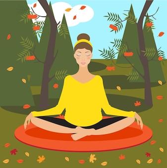秋の公園でヨガを練習している美しい少女と明るい色の写真