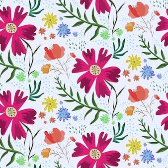 アクセントのピンクの花と明るくカラフルな花の夏のシームレスなパターン