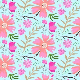 青い背景の夏のシームレスなパターンに明るい落書きピンクの花