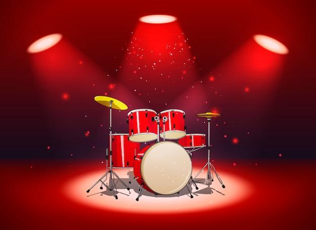 スポットライトの光の中で設定された明るい赤いドラム