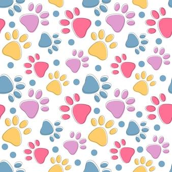 白い猫や犬の動物の足跡の背景にカラフルなペットの足と明るいシームレスパターン