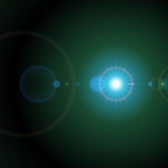 녹색 공간에서 밝은 별. 무지개 원이 갈라지는 은하계 플레어