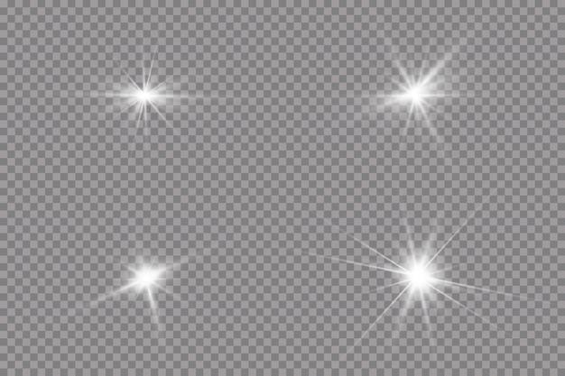 明るいサンバースト輝く星の太陽光線は透明な背景を分離しました