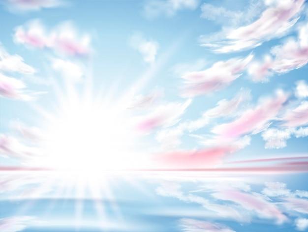 Яркое солнце, сияющее в небе, райский пейзаж с облачным небом и чистым озером