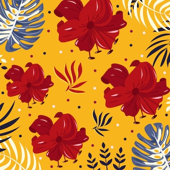 Bright tropical flowers and leaves on yellow background
