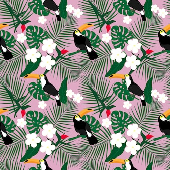Bright tropical seamless pattern with toucan and tropical leaves.