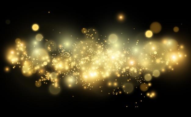 Блестящая золотая пыль светит. сверкающий блестящий световой эффект.