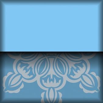 タイポグラフィ用に準備されたインドの白い装飾品が付いた青のパンフレット。