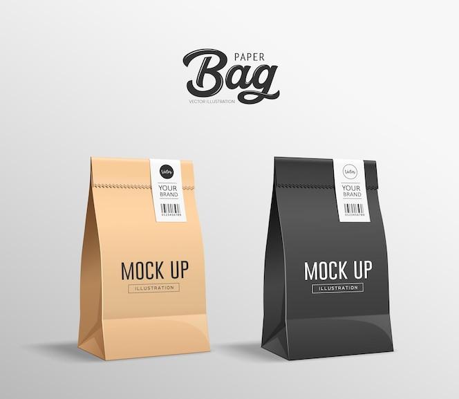 갈색과 검은 색 종이 봉투가 접혀 있고, 입 주머니에는 스티커가 있고, 컬렉션 디자인을 모의, 회색 배경에