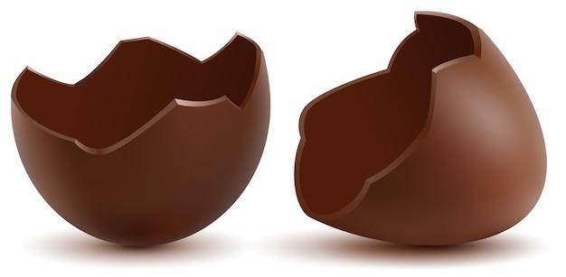 茶色の壊れたチョコレートの卵は殻を半分に割った