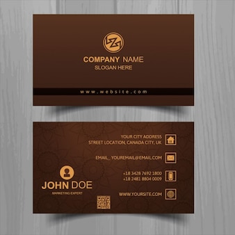 Brown business card with floral elements